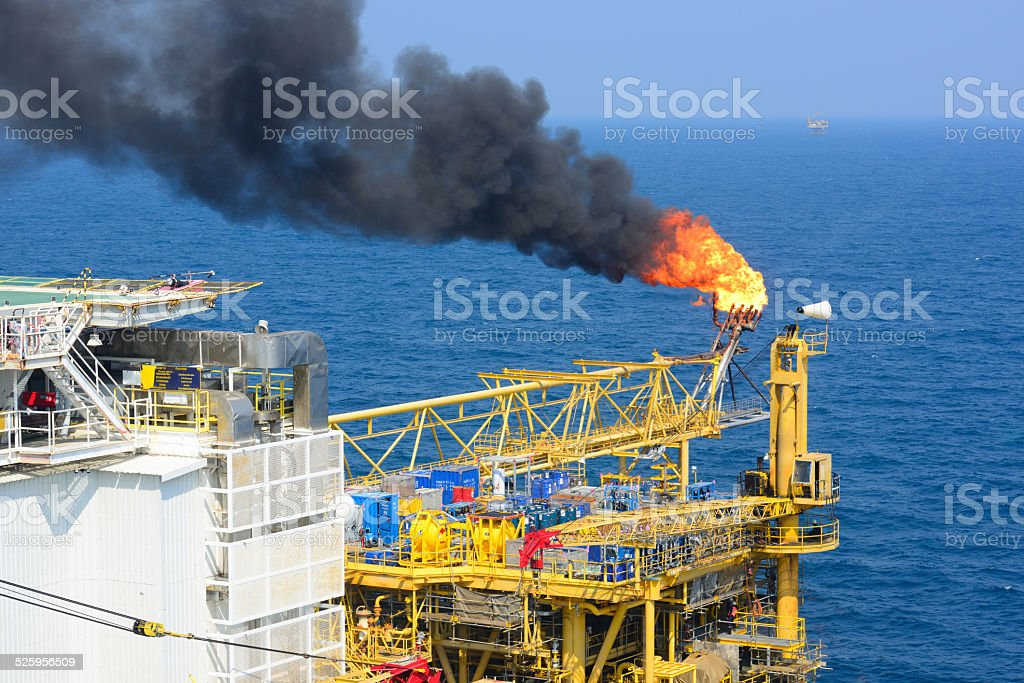 The gas flare is on offshore oil rig platform stock photo