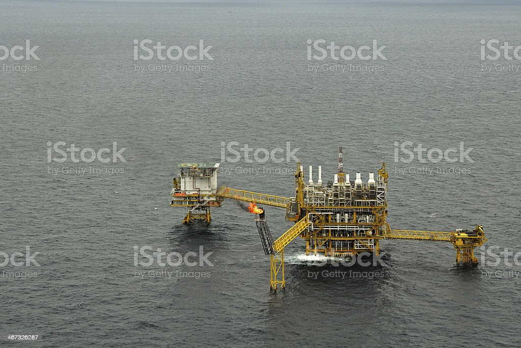 The gas flare is on oil rig platform royalty-free stock photo