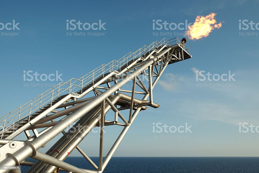 The gas flare is on the oil rig platform. stock photo