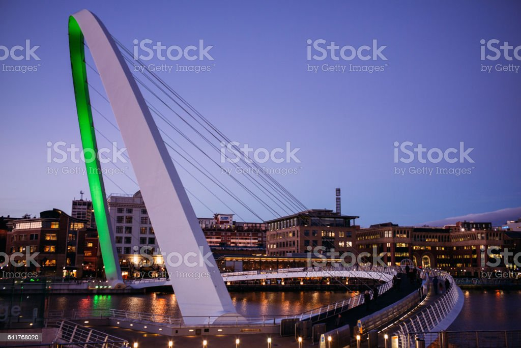 The Gateshead Millennium Bridge over the River Tyne in Newcastle, UK - side view stock photo