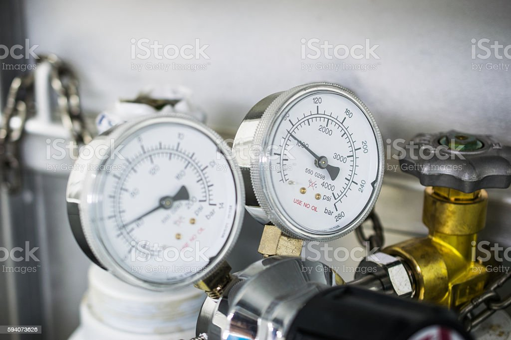 The gauge for measure and gas cylinder With Chain stock photo