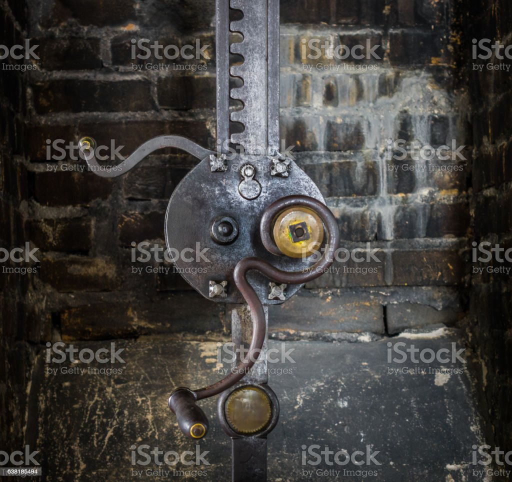 The  gear of an old mechanical device stock photo