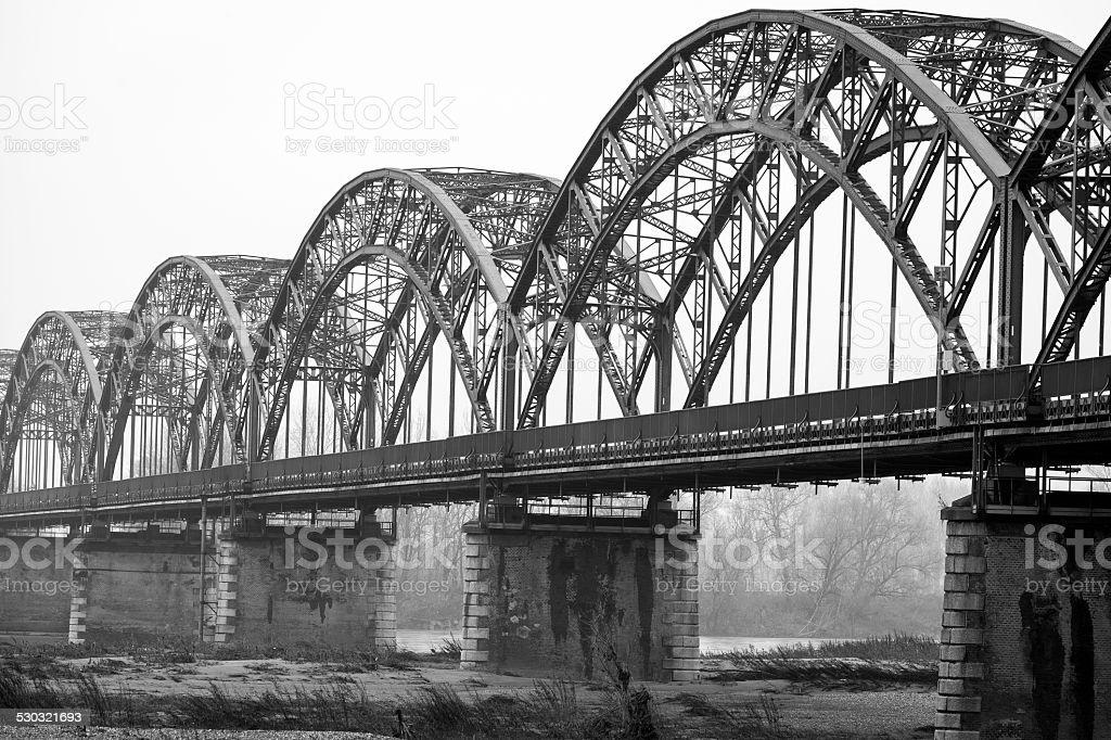 The 'Gerola' iron bridge, on the Po river. BW image stock photo