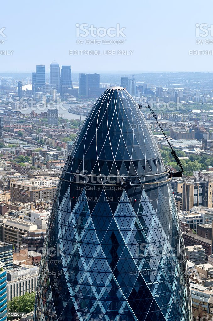 The Gherkin skyscraper and Canary Wharf, City of London royalty-free stock photo