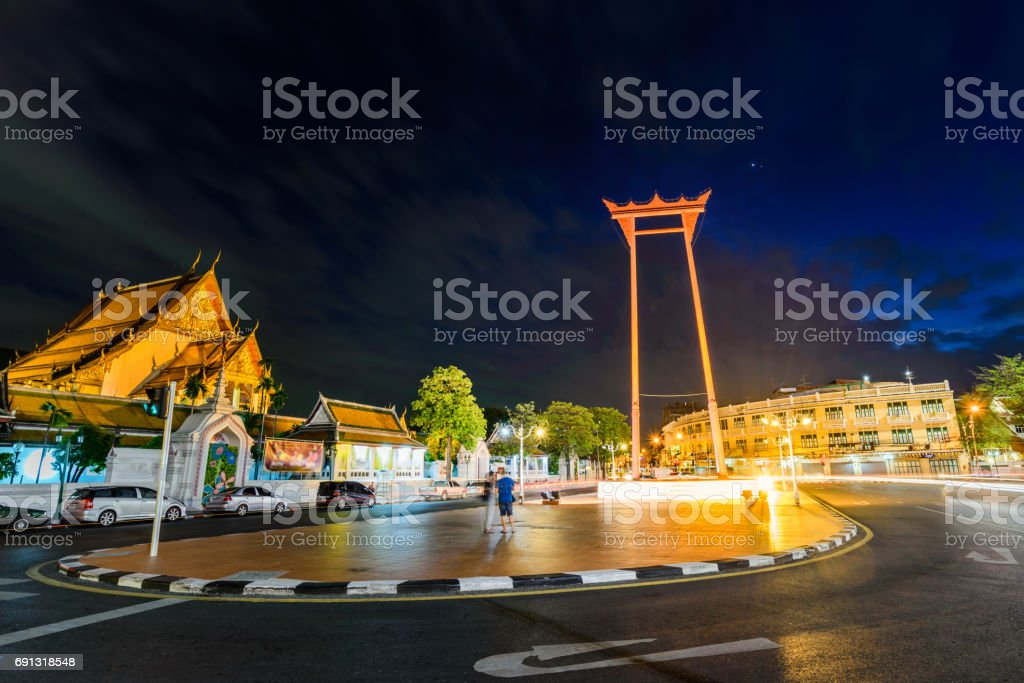 The Giant Swing and Suthat temple at twilight in Bangkok, Thailand. stock photo
