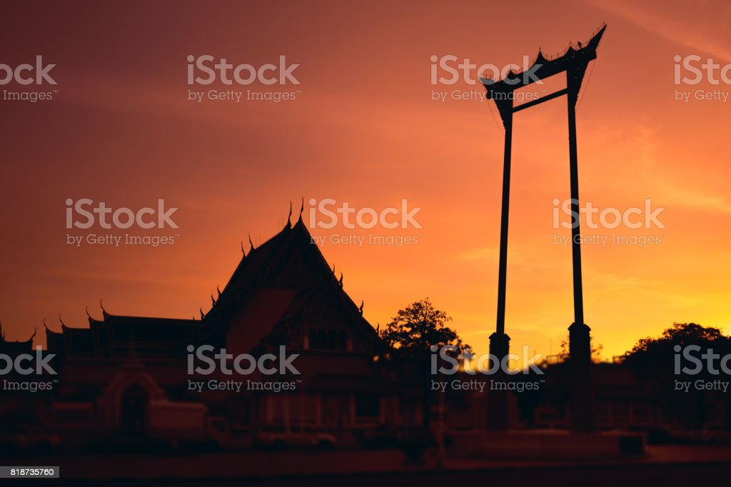 The giant swing and Wat Suthat temple silhouette stock photo