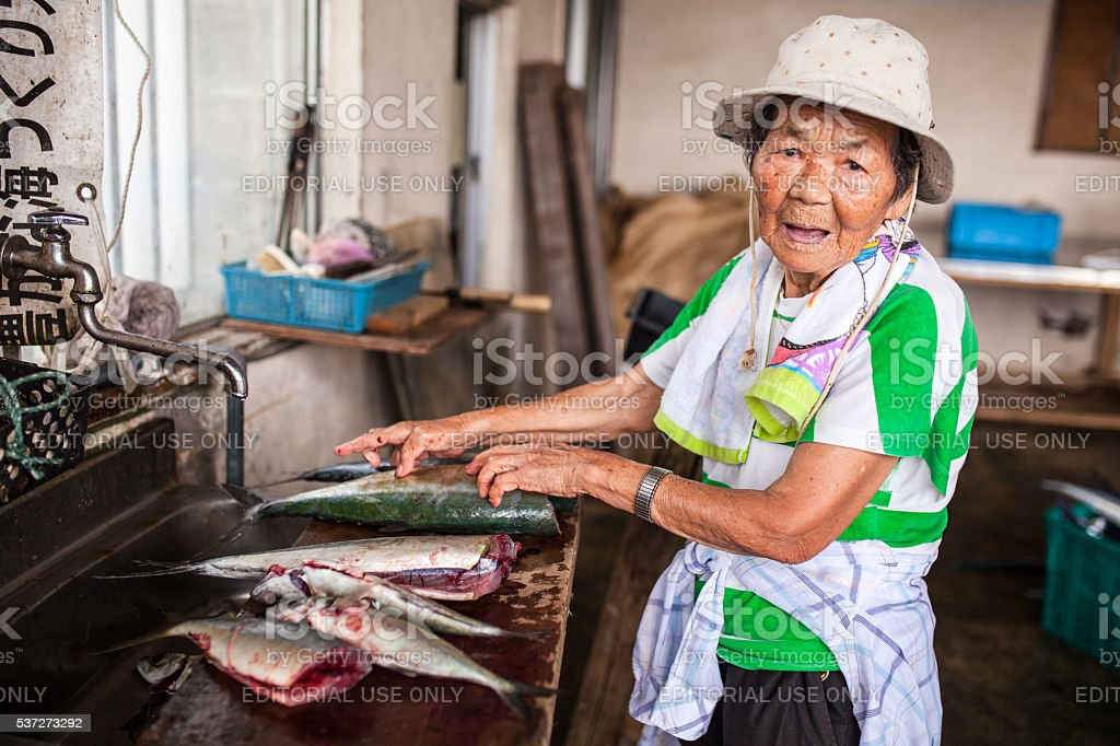 The Ginowan fish market prepares to auction off daily catch stock photo