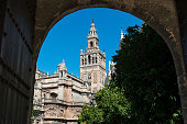 The Giralda in Seville through an arch