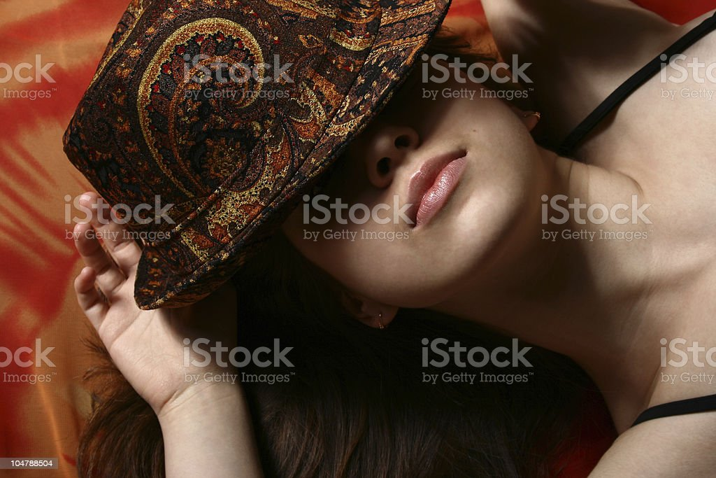The girl and a hat. royalty-free stock photo