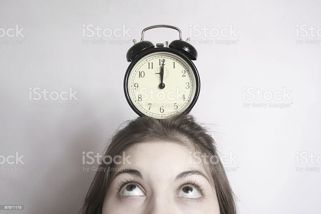 The girl and an alarm clock. royalty-free stock photo