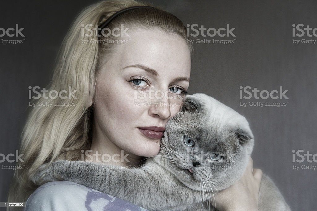 The girl and cat on hands royalty-free stock photo