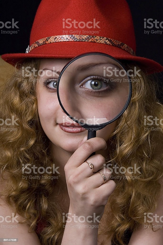 The girl and  magnifier royalty-free stock photo