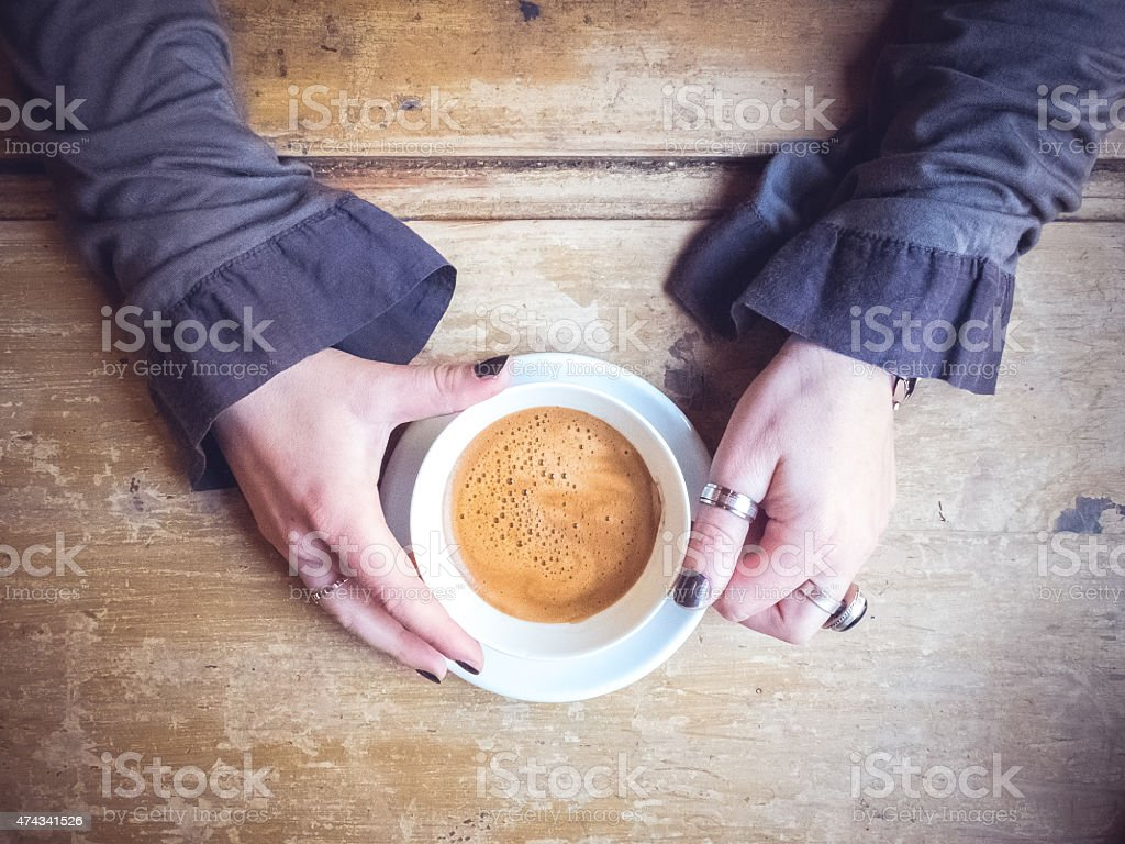 The girl and the coffee stock photo