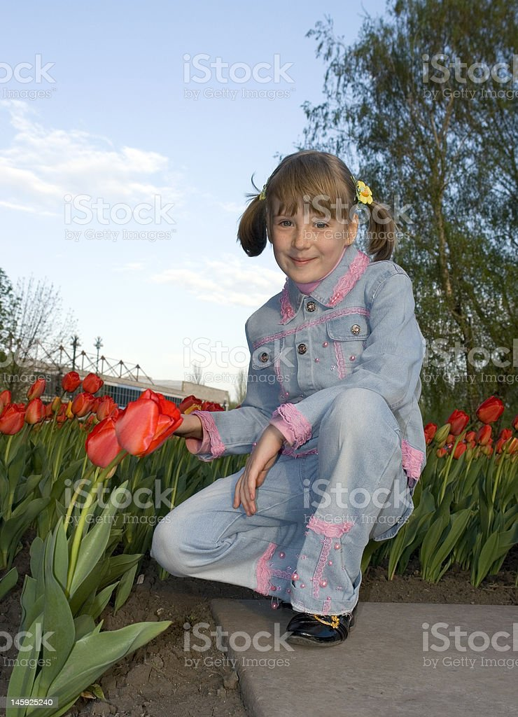 The girl and tulips stock photo
