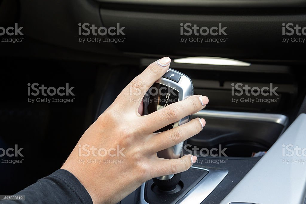 the girl behind the wheel of a car stock photo