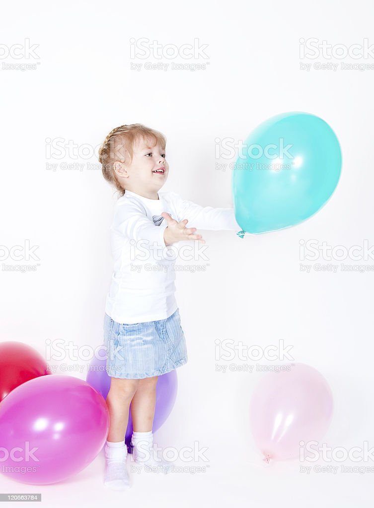 The girl catches balloon stock photo