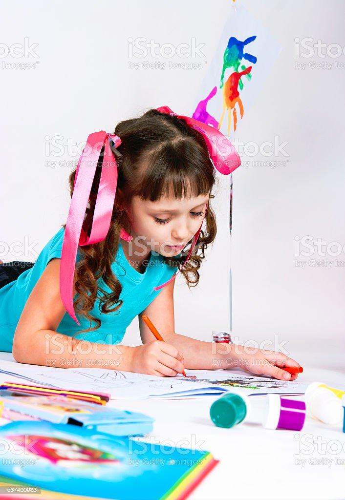 the girl draws lying on a floor stock photo