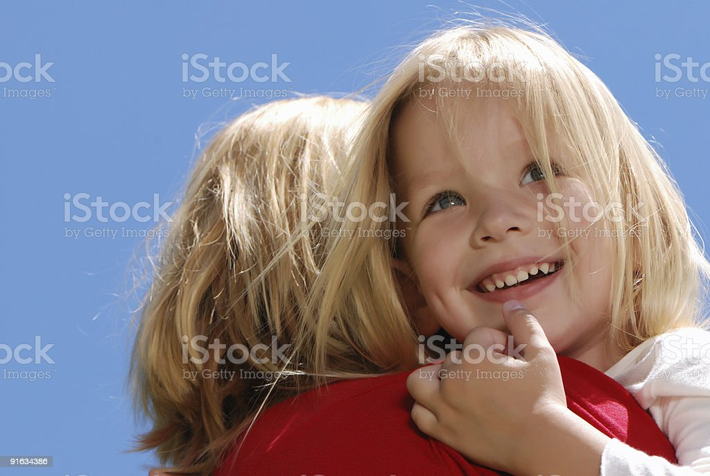 The girl embracing mother against  sky royalty-free stock photo