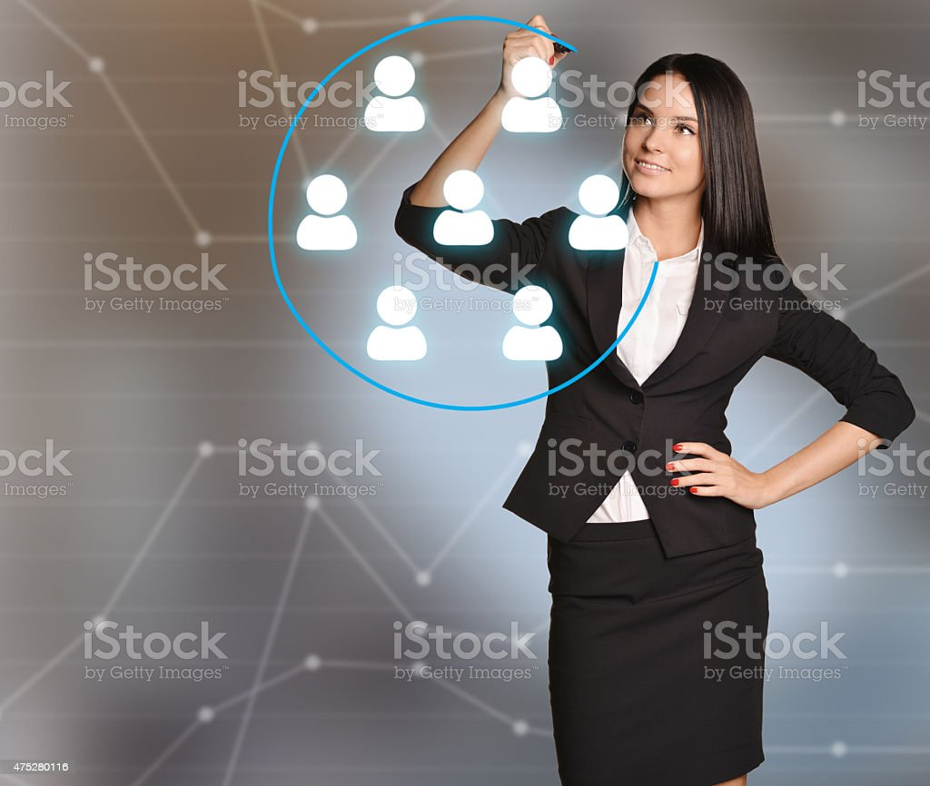 The girl from the Recruitment encircles a blue pen Staff stock photo