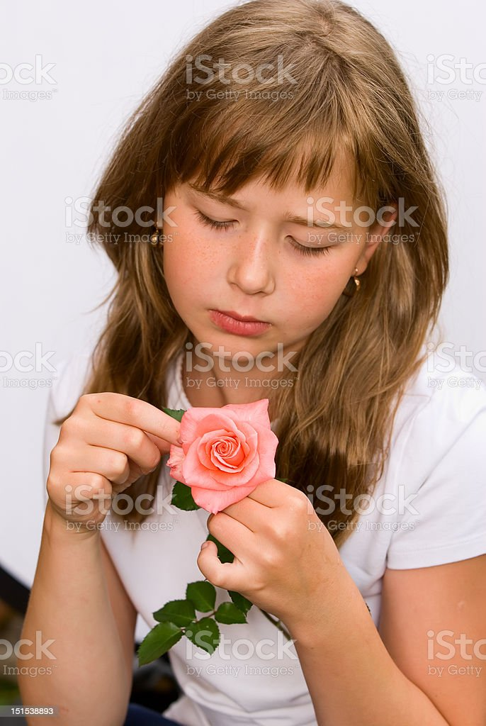 The girl handles a rose royalty-free stock photo