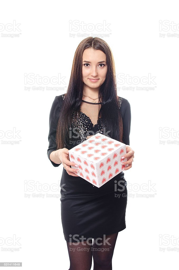 The girl holds a box with hearts in hand. stock photo