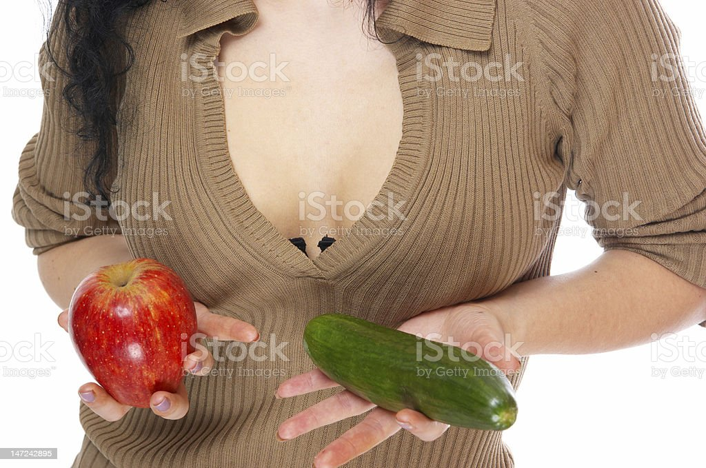 The girl holds an apple and a cucumber royalty-free stock photo