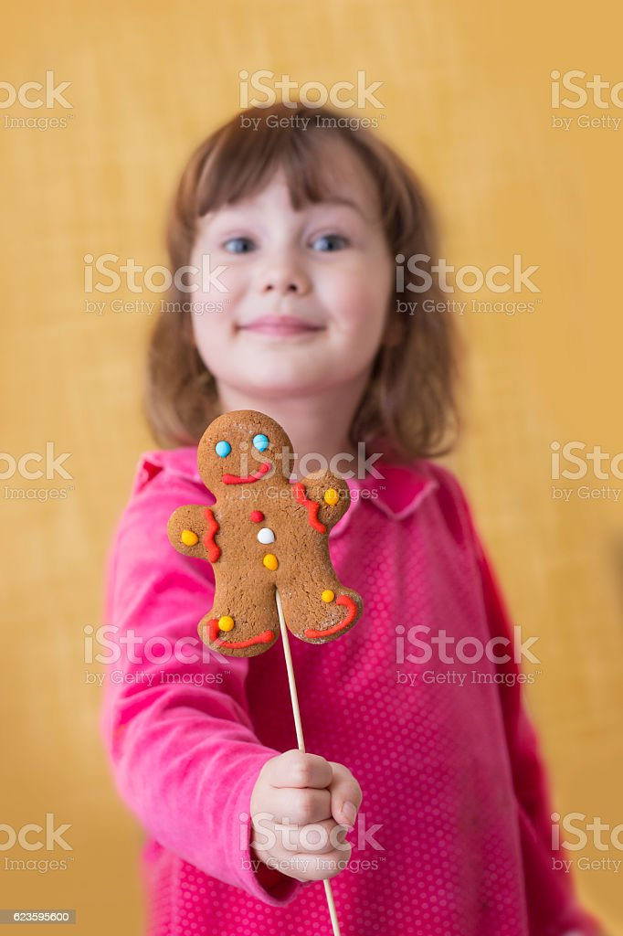 The girl holds gingerbread. Christmas entertainment stock photo
