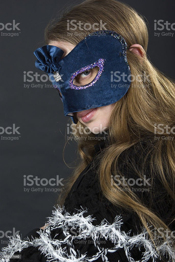 The girl in a mask royalty-free stock photo