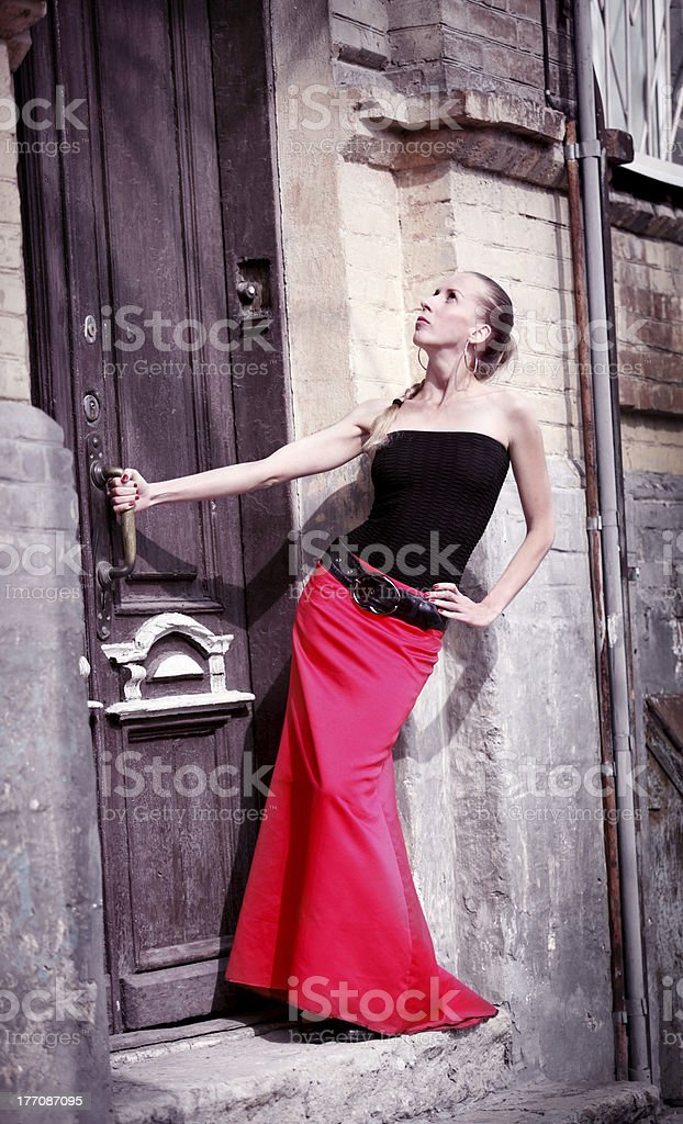 The girl in a red skirt royalty-free stock photo