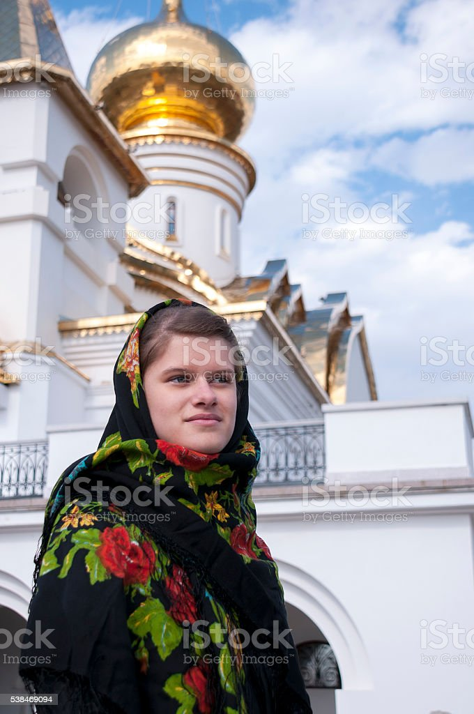 The girl in a scarf stands in thought stock photo