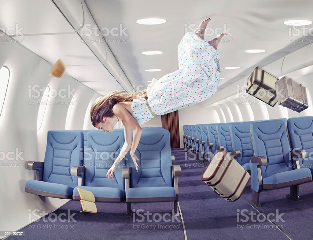 the girl in an airplane stock photo