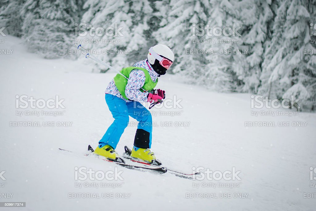 The girl in Karaman skis stock photo