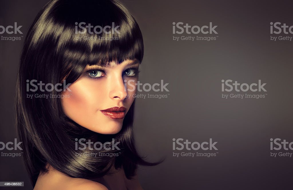 The girl in profile with black straight shiny hair. stock photo