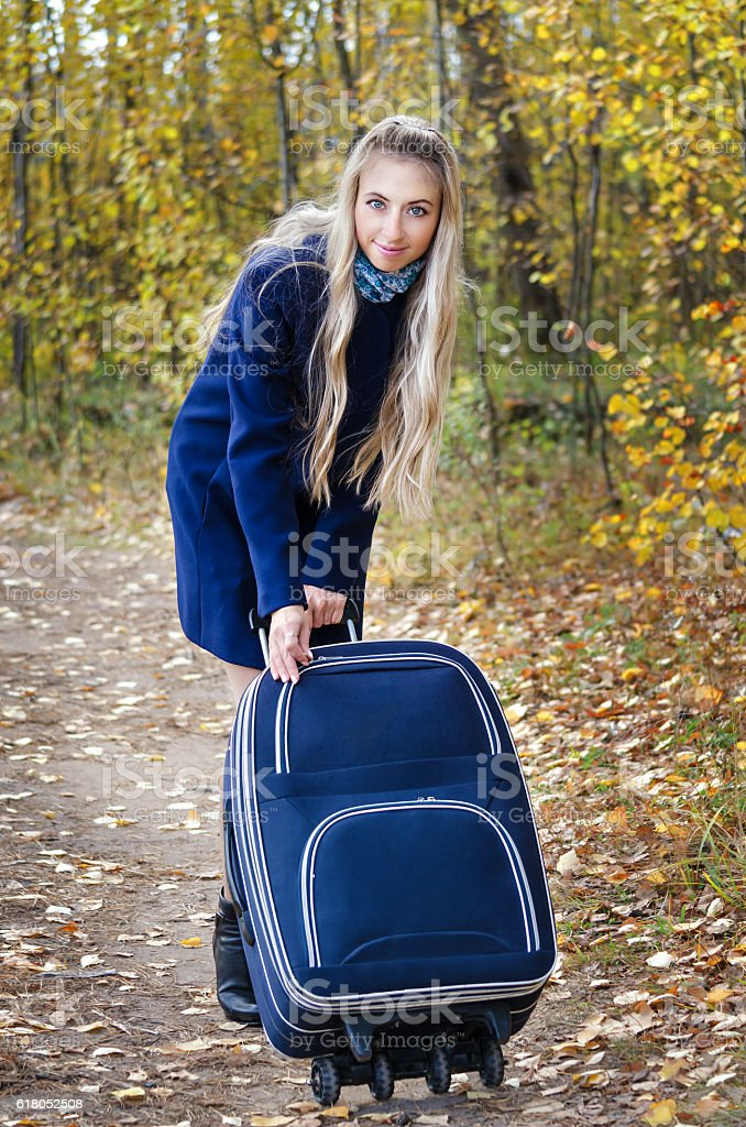 The girl in the blue coat and bag in the stock photo