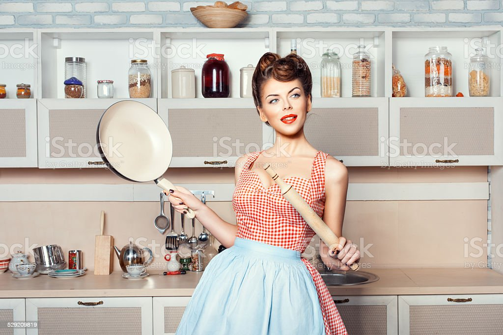 The girl in the hands of a rolling pin pan. stock photo