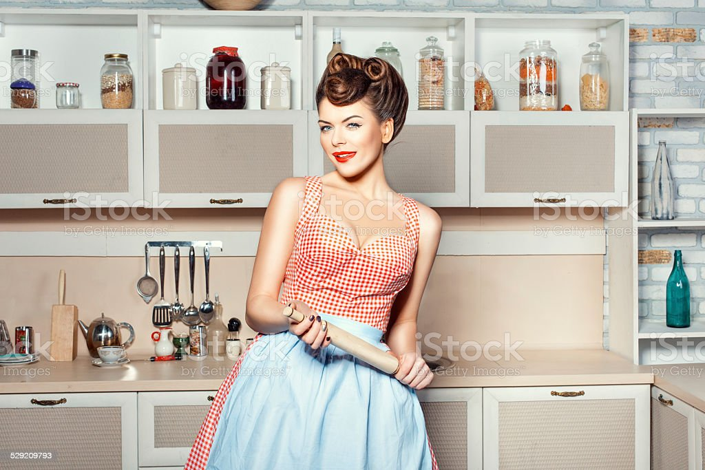 The girl in the hands of a rolling pin. stock photo