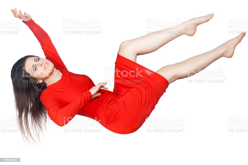 The girl in the red dress soars. stock photo