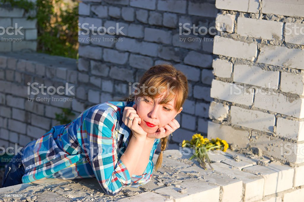 The girl in the window of an abandoned building stock photo