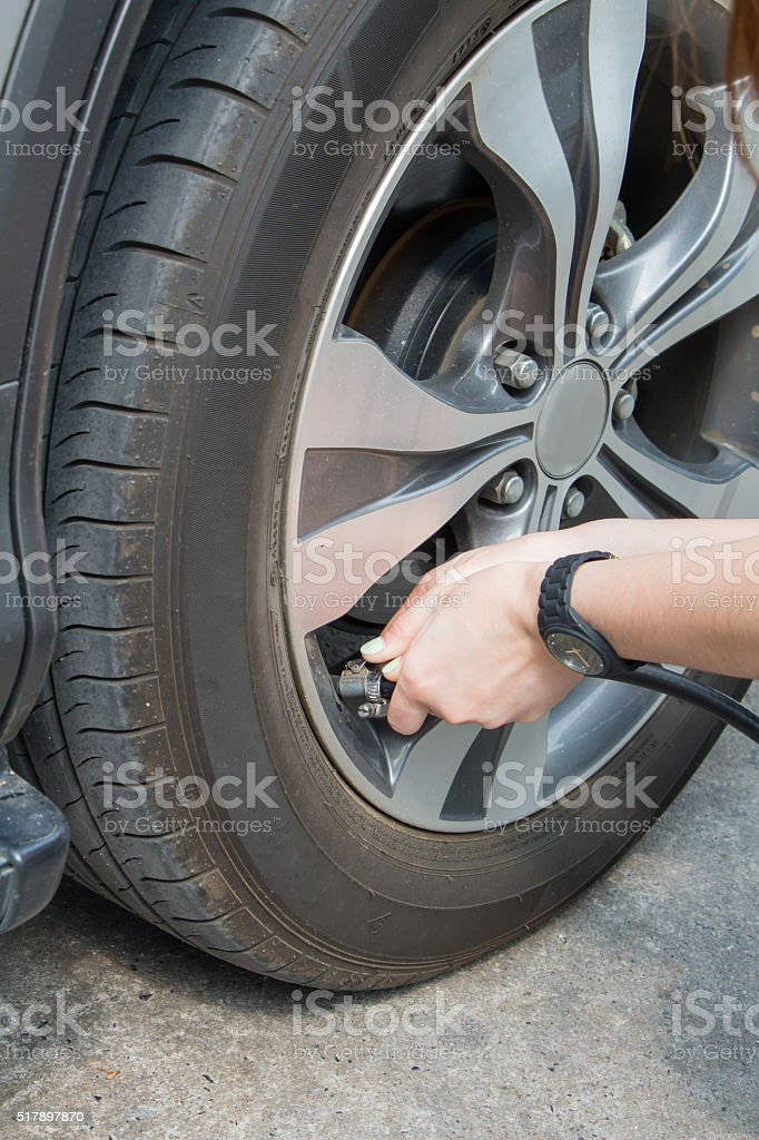 The girl inflate tires By her self stock photo
