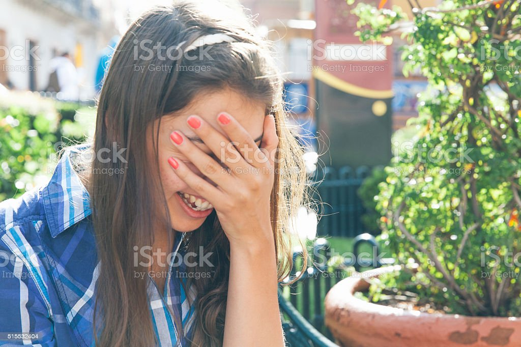the girl is covered with her face stock photo
