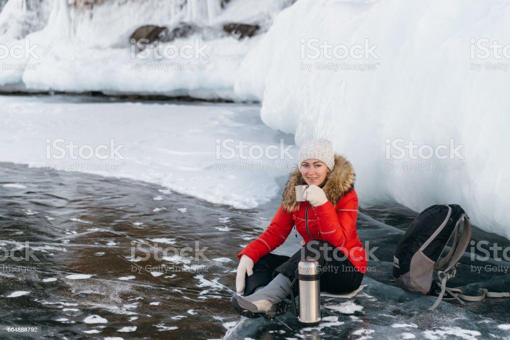 The girl is drinking tea on ice. stock photo