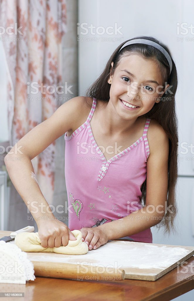 The girl is kneading dough royalty-free stock photo