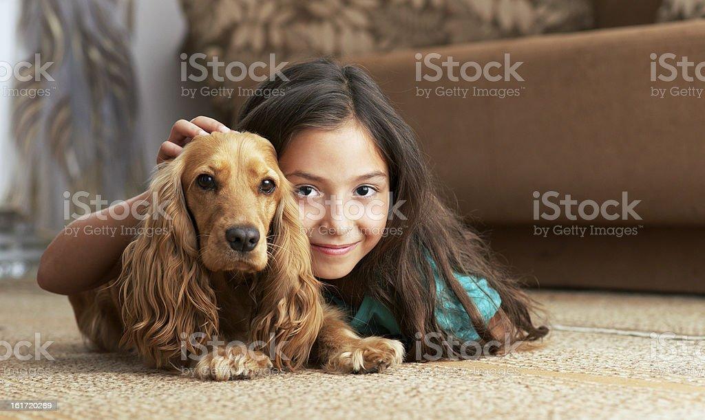 The girl is lying on floor stock photo