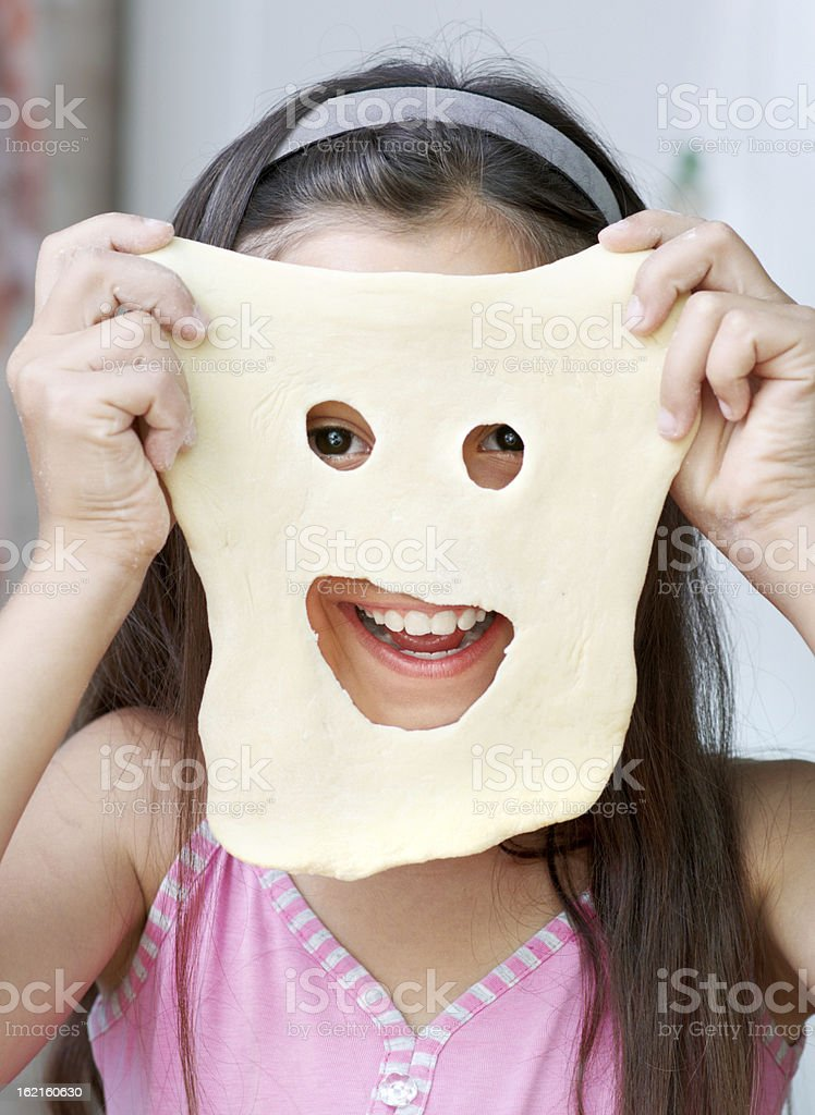 The girl is showing her mask royalty-free stock photo