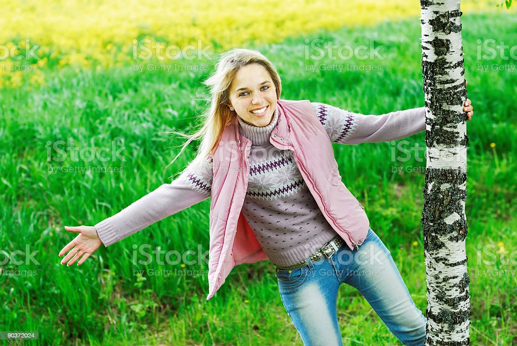 The girl is turned round a birch royalty-free stock photo
