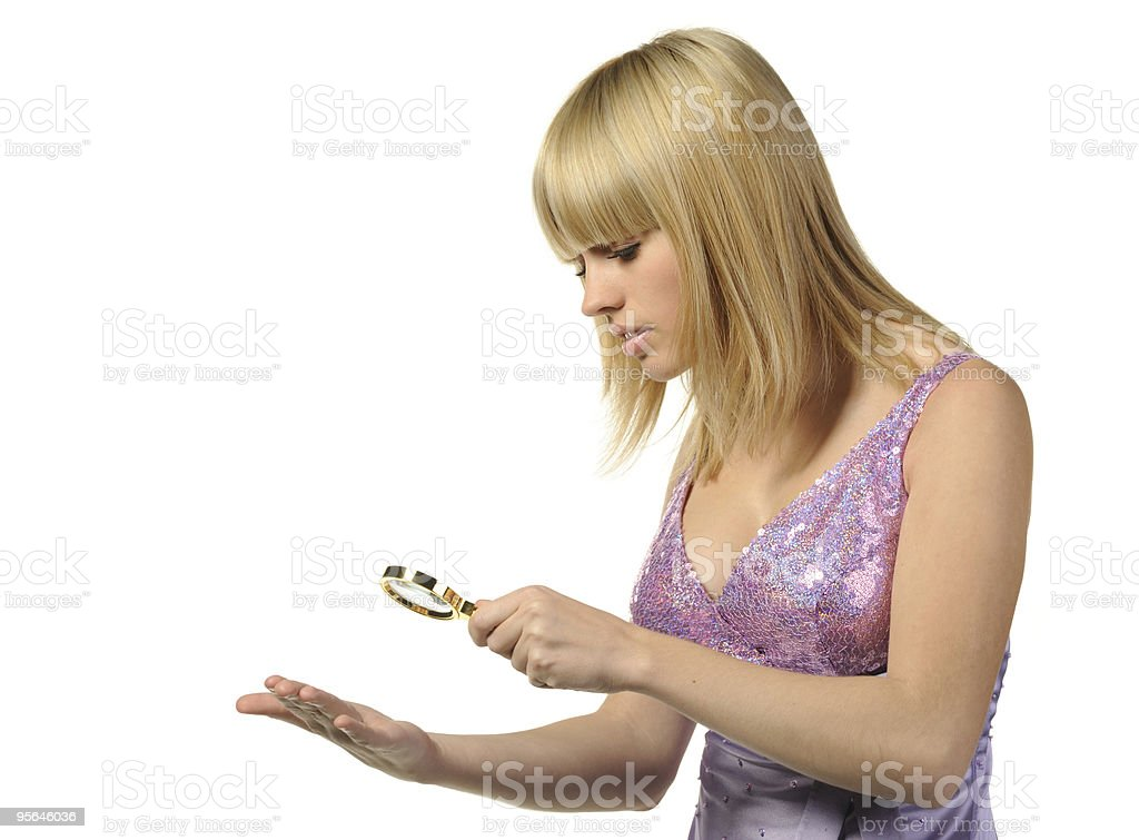 The girl looking at a hand through magnifier royalty-free stock photo