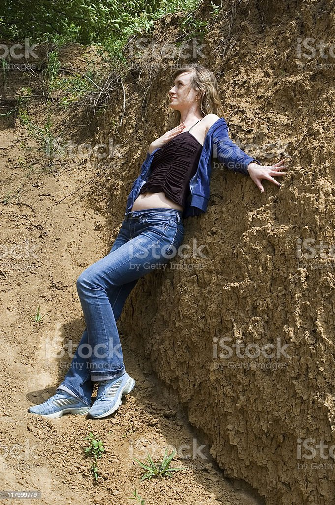 The girl near a clay wall stock photo