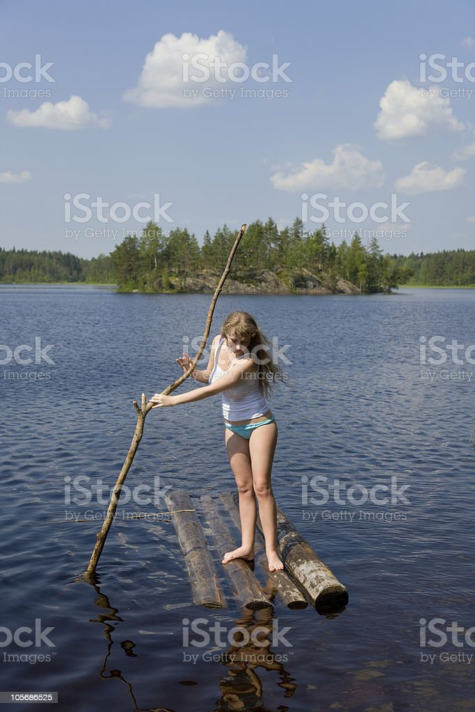 The girl on small wooden raft stock photo