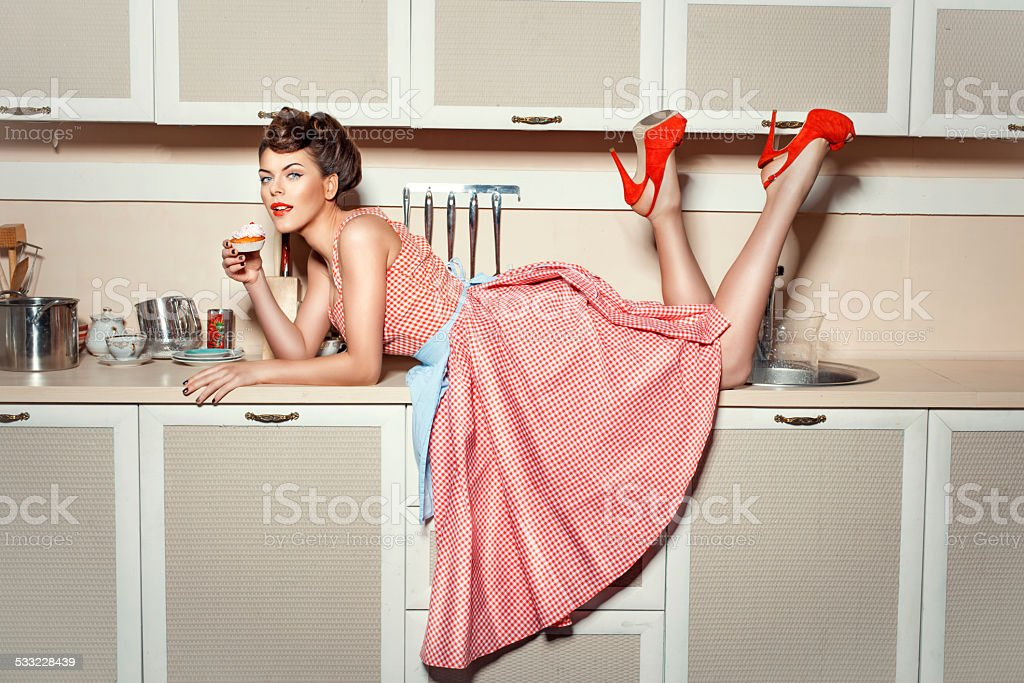 The girl on the kitchen table. stock photo