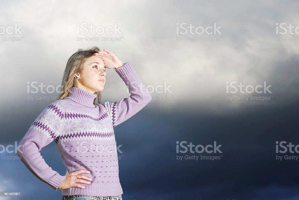 The girl peers afar royalty-free stock photo
